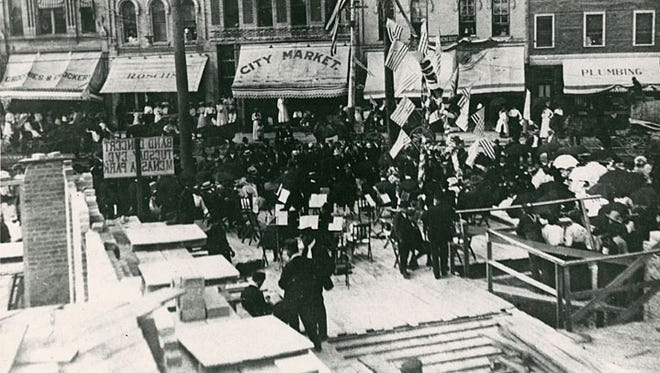 A ceremony to lay the cornerstone of the Menasha Hotel was held in 1905. The view is looking north across Main Street.