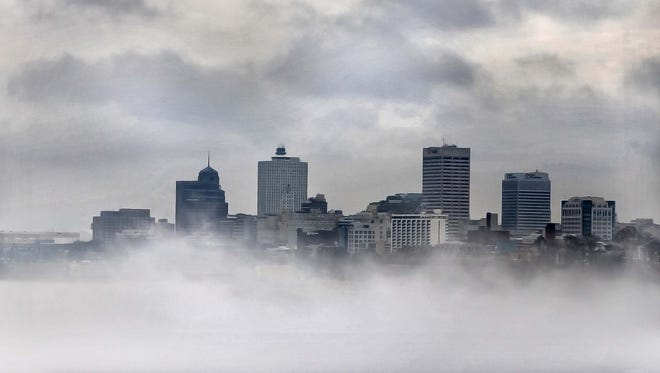The Memphis skyline emerges from the fog as it is burned away Wednesday morning February 8, 2017 viewed from the Big River Crossing. In parts of the city commuters had to cope with pea soup after two days of record high temperatures in the Mid-South.