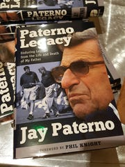 "Copies of ""Paterno Legacy,"" the book Jay Paterno wrote about his father, former Penn State football coach Joe Paterno. Jay Paterno spoke to the Southwest Florida chapter of the Penn State alumni association at Vi at Bentley Village on Tuesday, Feb. 20, 2018."