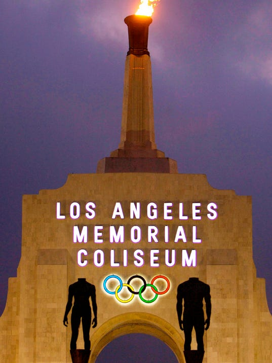 FILE - This Feb. 13, 2008, file photo shows the facade of The Los Angeles Memorial Coliseum in Los Angeles. The Los Angeles bid committee for the 2024 Olympics is projecting a $5.3 billion budget, a number that would be less than half the cost of the recently completed Rio de Janeiro Games and about a quarter of where Tokyo's ballooning budget for 2020 currently stands. Bid officials say they can do this because more than 30 venues already exist and those that don't will be built as temporary structures.  (AP Photo/Damian Dovarganes, File)