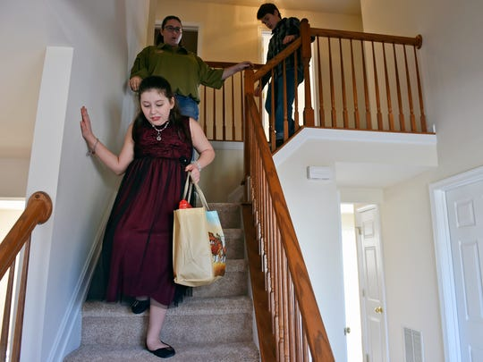 Isabella Verdinelli, 11, leads the way down the stairs