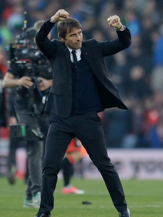 FILE - In this file photo dated Saturday, April 8, 2017, Chelsea's manager Antonio Conte celebrates at end of the English Premier League soccer match between Bournemouth and Chelsea at Dean Court stadium in Bournemouth, England.  Conte remembers when he was a soccer player and scored a goal against Manchester United in 1999, he recounts Friday April 14, 2017, and now as a manager will lead Chelsea into their Premier League match against Manchester United on upcoming Sunday. (AP Photo/Matt Dunham, FILE)
