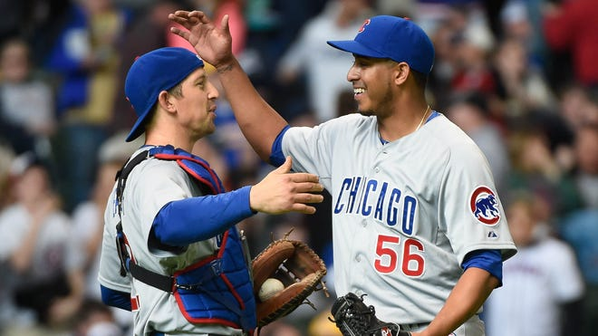 Cubs pitcher Hector Rondon, right, has converted all three of his save opportunities this season. His 1.69 ERA and 1.19 WHIP are definitely closer-worthy.