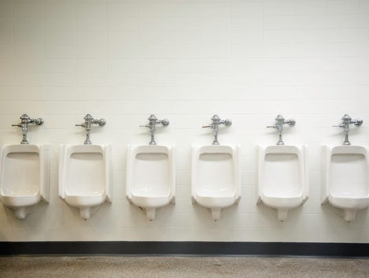 Photograph of a row of six white urinals