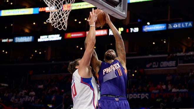 Oct 22, 2014: Phoenix Suns forward Markieff Morris (11) shoots against Los Angeles Clippers forward Spencer Hawes (10) during the first half at Staples Center.