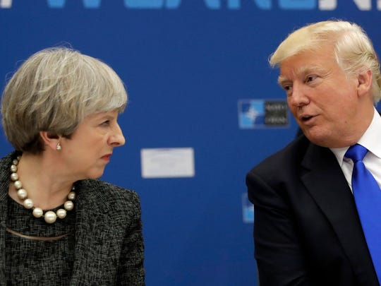 President Trump, right, speaks to British Prime Minister Theresa May during a working dinner meeting at the NATO headquarters during a NATO summit of heads of state and government in Brussels on May 25, 2017.