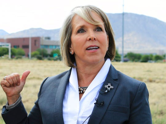 Democratic U.S. Congresswoman Michelle Lujan Grisham of New Mexico talks about efforts to secure federal funding for a planned multimillion-dollar building for the National Nuclear Security Administration during a groundbreaking ceremony in Albuquerque, N.M., on Monday, July 2, 2018.