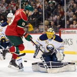 Linus Ullmark makes the save as Jarret Stoll creates a screen during Tuesday's 3-2 Sabres victory over the Wild.