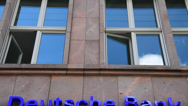The logo of Germany's biggest lender Deutsche Bank is seen on a branch of the bank in Berlin's Mitte district on September 30, 2016. (AFP PHOTO / TOBIAS SCHWARZ/AFP/Getty Images)