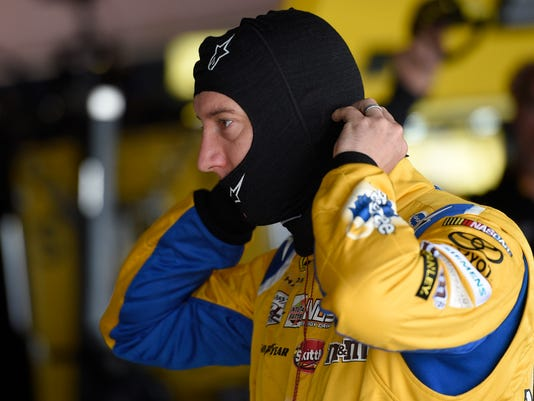 Kyle Busch gets ready before final practice for the NASCAR Sprint Cup series auto race, Saturday, May 14, 2016, at Dover International Speedway in Dover, Del. (AP Photo/Nick Wass)