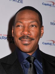 Honoree Eddie Murphy poses on the red carpet during the 18th Annual Mark Twain Prize For Humor at The John F. Kennedy Center for Performing Arts on Oct. 18, 2015 in Washington.