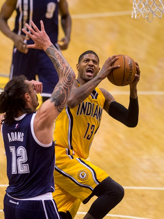 Indiana Pacers forward Paul George (13) puts up a shot from under the basket as he's guarded by Oklahoma City Thunder center Steven Adams (12) during the second half of an NBA basketball game Saturday, March 19, 2016, in Indianapolis. Thunder won 115-111. (AP Photo/Doug McSchooler)