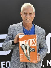Olympic gold medalist Greg Louganis poses with his