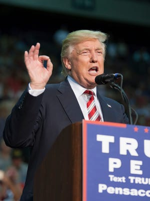 Donald Trump speaks during a Trump Rally at the Pensacola Bay Center on Friday, September 9, 2016. Hundreds of protesters will demonstrate Sunday at the airport against his order banning citizens from seven predominantly Muslim countries from entering the United States.