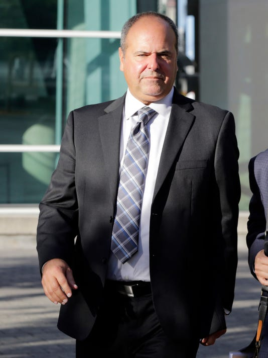 Sports agent Bartolo Hernandez leaves federal court, Wednesday, Feb. 1, 2017, in Miami. Lawyers for the sports agent and a trainer told jurors they ran legitimate businesses and were not involved with illegal smuggling of Cuban baseball players from the communist island. (AP Photo/Lynne Sladky)