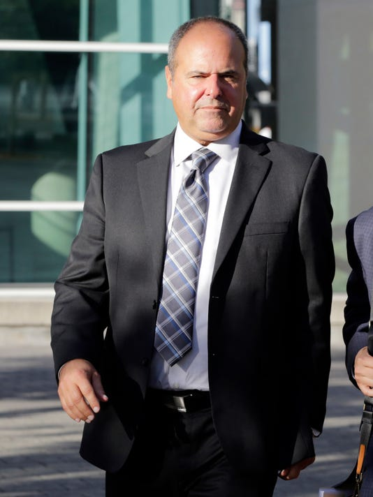 FILE - In this Feb. 1, 2017, file photo, sports agent Bartolo Hernandez leaves federal court in Miami. Prosecutors have shown jurors in the trial of sports agent Hernandez and baseball trainer Julio Estrada that dozens of player documents are bogus. The documents are required for Cuban players to enter the U.S. and to negotiate lucrative free agent contracts.(AP Photo/Lynne Sladky, File)