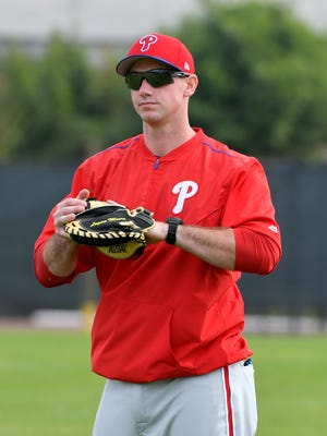 Phillies bullpen catcher Bob Stumpo, a Delaware native and Salesianum graduate, plays catch before Saturday's spring training workout at the Carpenter Complex.