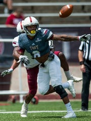 Troy's Jalen Harris (9) breaks up a pass intended for