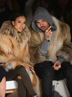 Karrueche Tran, seen here with then boyfriend Chris Brown in February 2015, won a five-year restraining order against him Thursday.