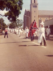 Members of the Ku Klux Klan march to Lee Square in downtown Pensacola on Saturday, May 24, 1975, in Pensacola.