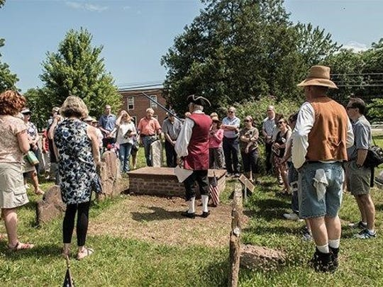 Visitors listen at a tour of the Whippany Burying Yard,