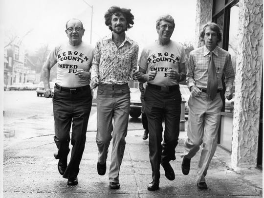 Tom Fleming, second from left, shown in this 1979 photo for the Bergen County United Fund. At right, four-time Boston Marathon winner Bill Rodgers.