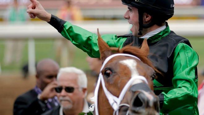 Jockey Florent Geroux celebrates after winning a Breeders' Cup race last November.