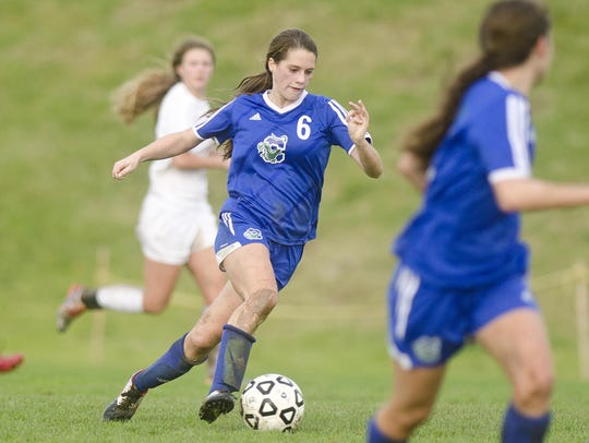 Colchester's Autumn Hathaway (6) races up field with