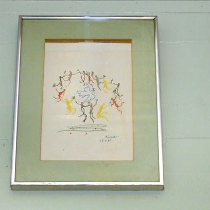 A numbered Picasso print hangs in the kitchen of the