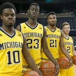 (From left) Michigan's Derrick Walton Jr., Caris LeVert, Zak Irvin and Spike Albrecht pose for a photo during the team's media day Oct. 22, 2015.