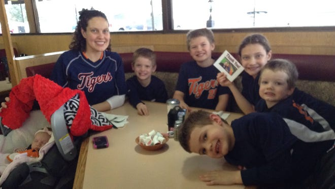 "Becky Ferraro and her children Emmalee, Owen, Isaac, Grace, Nolan and Ethan wore the Detroit Tigers gear in honor of ""Mr. Bill"" Riddle."