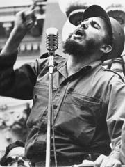 In in this Feb. 6, 1959, file photo, Cuba's leader Fidel Castro speaks to a crowd during his triumphant march to Havana after the fall of the Batista regime.