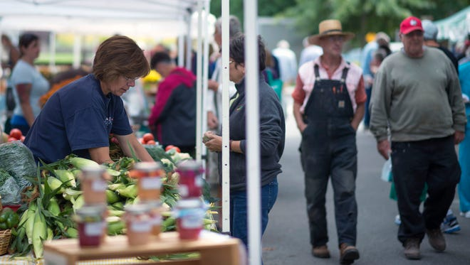 Grove Park bustles with visitors for the Rehoboth Beach Farmers' Market Tuesday afternoon, September 23.