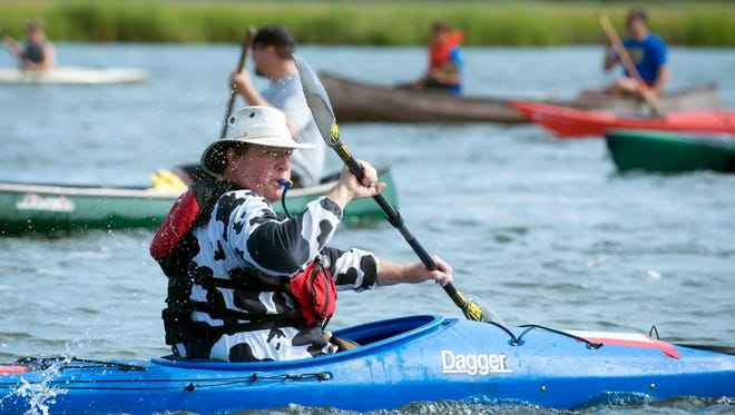 Racers get in the water before the Broadkill Canoe & Kayak Race kicks off in Milton. Visitors to the coast spend nearly $50 in local communities during their visit, a new study says.