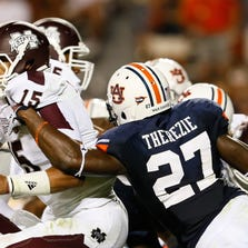 AUBURN, AL - SEPTEMBER 14:  Robenson Therezie #27 of the Auburn Tigers tackles Dak Prescott #15 of the Mississippi State Bulldogs at Jordan-Hare Stadium on September 14, 2013 in Auburn, Alabama.  (Photo by Kevin C. Cox/Getty Images)