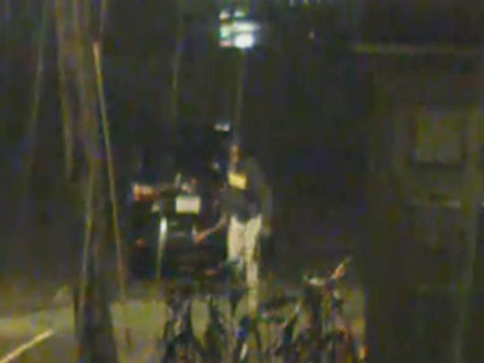 A suspect caught on video Sunday morning vandalizing