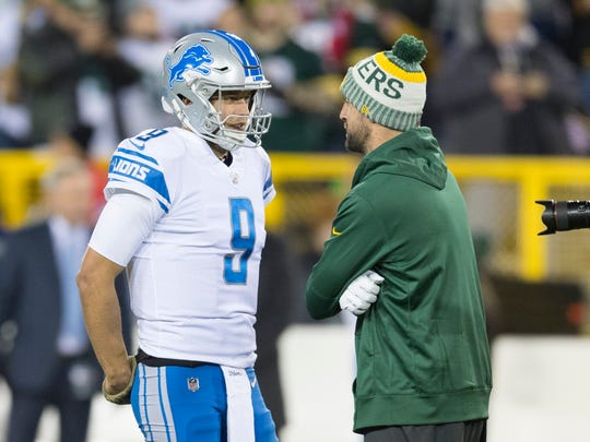 Lions quarterback Matthew Stafford talks with injured Packers quarterback Aaron Rodgers prior to the game at Lambeau Field, Monday, Nov. 6, 2017 in Green Bay.
