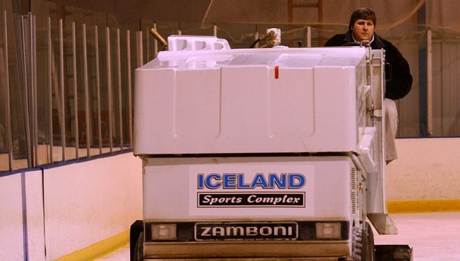 A 2003 file photo of a Zamboni being driven at Iceland skating rink. Behind the wheel is manager Chris Richardson.