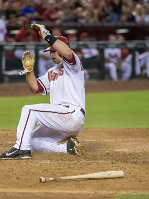 Diamondbacks' Paul Goldschmidt slides in sadly for a run to tie the game in the fourth inning against the Giants at Chase Field in Phoenix, AZ on Friday, June 20, 2014.