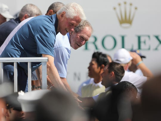 Former presidents, Bill Clinton and George W. Bush