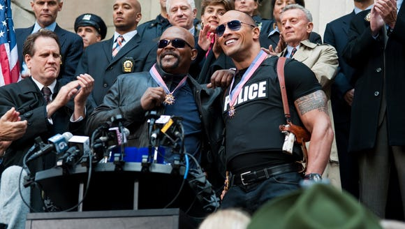 "Samuel L. Jackson (left) and Dwayne Johnson are New York's finest in ""The Other Guys."""