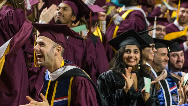 Shawn Sickler, on left, looks at his family rejoicing during the Commencement for Graduate Students held at ASU Wells Fargo Center on Monday, December 12,  2016.