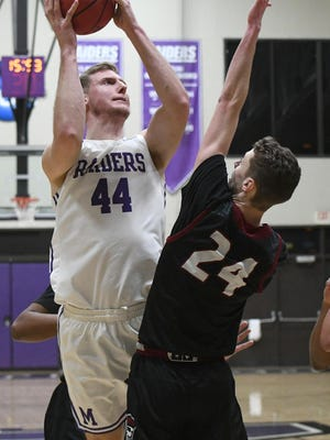 Mount Union senior John Carroll shoots over Cairn defender Wes Murray in the an NCAA Division III tournament first round game this year.