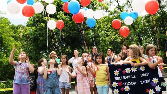 Balloon releases like this one in 2012 where Brownies, Daisies, and troop leaders release balloons bearing messages to veterans, would be banned under a bill making its way through Trenton.