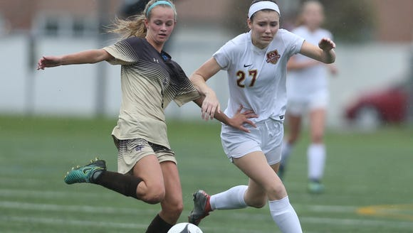Clarkstown South's Caroline Kelly battles Arlington's Kaylee Sturans for the ball during the Section 1 Class AA final on Oct. 29.