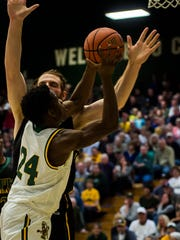 UVM's Ben Shungu manages to get a layup past UMFK's