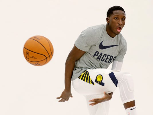 Indiana Pacers' Victor Oladipo poses for photos during the NBA basketball team media day, Monday, Sept. 25, 2017, in Indianapolis. (AP Photo/Darron Cummings)