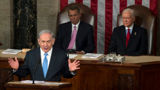 Israeli Prime Minister Benjamin Netanyahu speaks before a joint meeting of Congress on Tuesday.