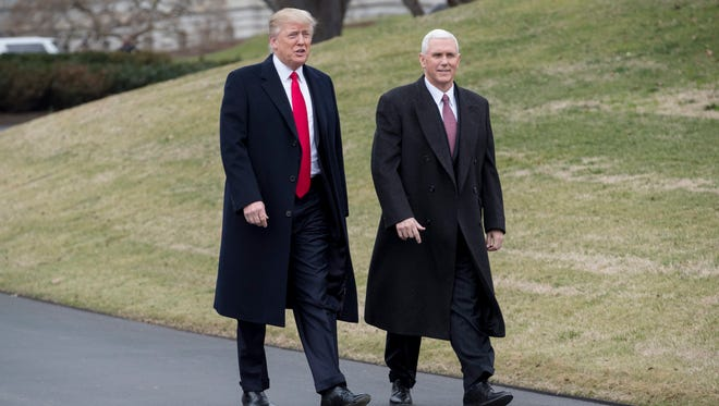 President Trump and Vice President Pence walk on the South Driveway of the White House to greet Harley Davidson executives and union representatives on Feb. 2, 2017.