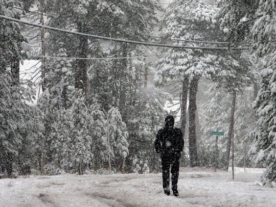 A Oct. 17, 2016, file photo shows snow blanketing an